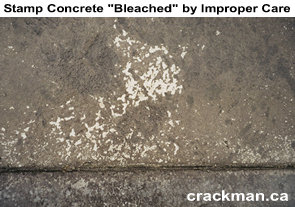 This photo shows a Rockprint stamp concrete driveway where the concrete sealer has been removed either by incorrect application of the sealer or removal of the concrete sealer from incorrect pressure washing or concentrated road salt dripping in the same place from the wheel wells of a vehicle.